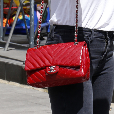 Daisy Lowe's red patent Chanel handbag
