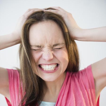 woman-stress-health-head-in-hands-work
