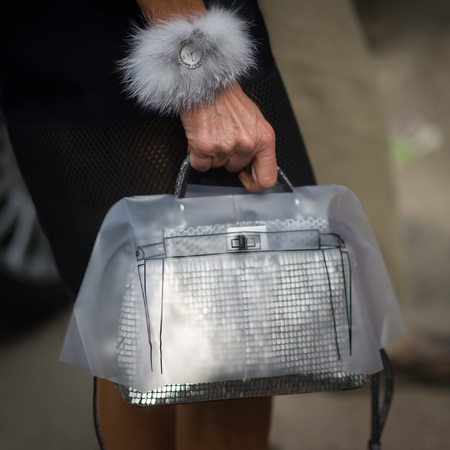 anna dello russo-fendi handbag wth raincoat-plastic cover-protect your handbag from rain-fashion editor-vogue japan-milan fashion week men-handbag.com