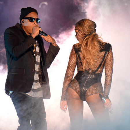 beyonce-joint tour with jay z-on the run-black fishnet leotard-flashing bum-versace stage costume-handbag.com