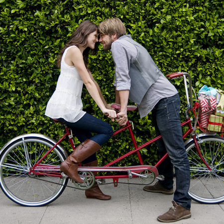 Couple on a date riding a tandem