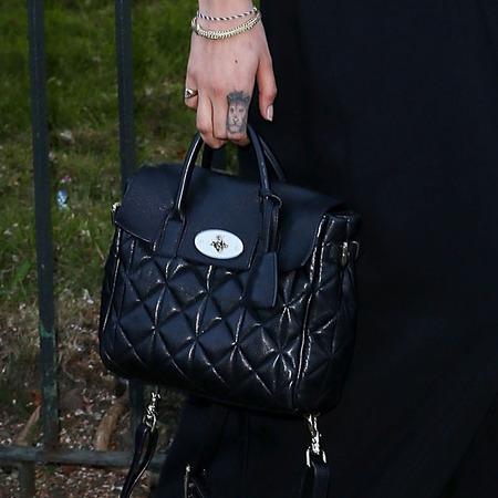 cara delevingne-serpentine gallery party 2014-mulberry black dress-quilted black backpack bag-celebrity fashion-handbag.com
