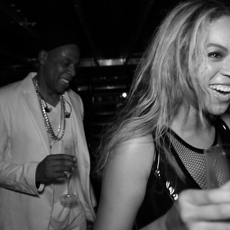 jay z and beyonce still loved up after solange fight - beyonce and jay z laughing and drinking champagne - day bag - handbag