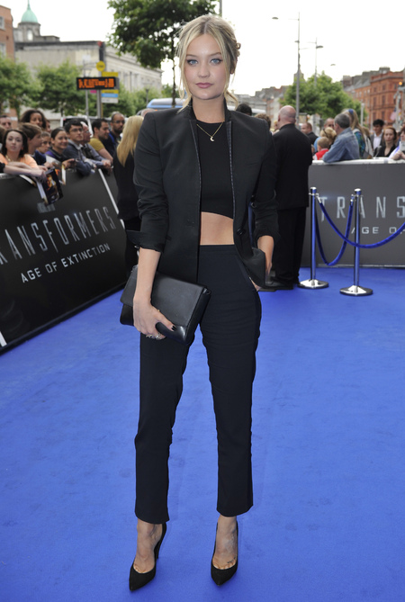 Laura Whitmore - tuxedo suit fashion trend - black jacket trousers crop top - armarni clutch bag - handbag.com