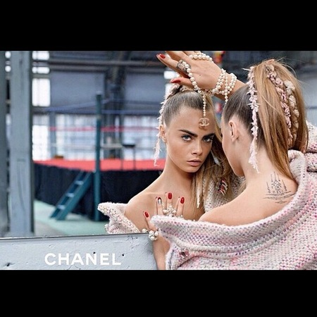 cara delevingne-chanel autumn winter 2014 ad campaign-chanel necklace-pink tweed dress-ponytail trend-handbag.com