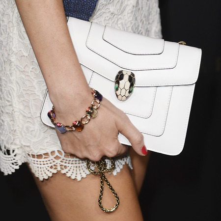 Poppy Delevingne's white Bulgari bag