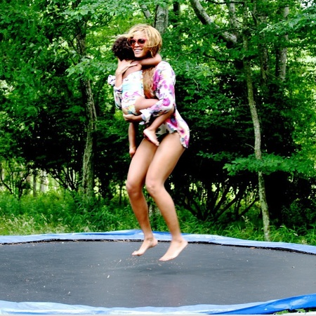 beyonce and blue ivy on trampoline - mums we like to follow on social media - baby bag - handbag.com