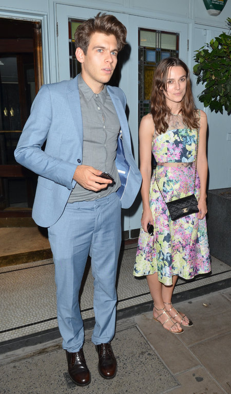 keira knigtley and james righton nail couple fashion- keira floral dress james blue suit - shopping bag - handbag.jpg